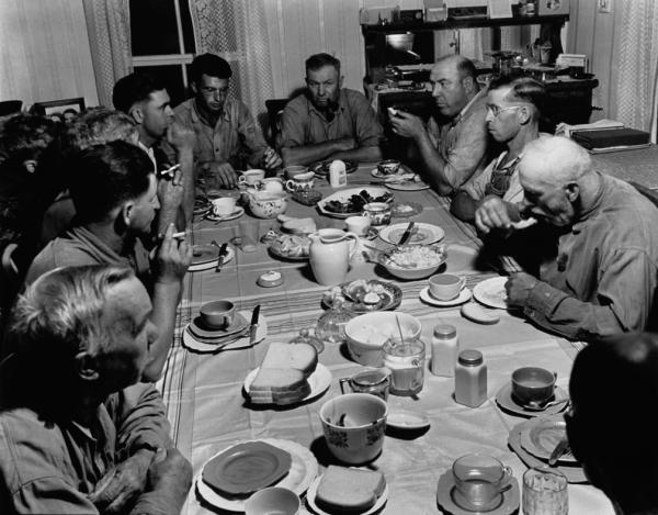 Image 1 - Farmers around a table eating